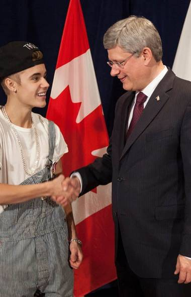 Oh my god what a terrible outfit to wear to the presentation of a Diamond Jubilee Medal in Ottawa on Friday! The ill-fitting work clothes, the unnecessary accessories, the clichéd reversible lid .... Try to do better next time, Stephen Harper! (Flickr)