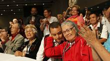 After the third ballot, Shawn Atleo was re-elected as National Chief of The Assembly of First Nations in Toronto on July 18, 2012. He is getting a hug from his great aunt, Flossie Atleo, in red. (Peter Power/The Globe and Mail)