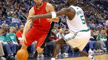 Toronto Raptors centre Andrea Bargnani, left, drives to the basket around Boston Celtics forward Kevin Garnett in the first quarter of their NBA preseason basketball game in Hartford, Connecticut, October 14, 2009. (BRIAN SNYDER)