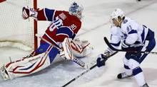 Montreal Canadiens goalie Peter Budaj (30) makes a save on Tampa Bay Lightning center Steven Stamkos (91) during the second period of NHL hockey action in Montreal, April 4, 2012. (OLIVIER JEAN/REUTERS)