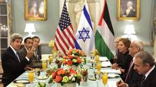 U.S. Secretary of State John Kerry (L) hosts an Iftar dinner for Israeli Justice Minister Tzipi Livni (3rd R) and Palestinian chief negotiator Saeb Erekat (2nd R) at the State Department in Washington July 29, 2013. (YURI GRIPAS/REUTERS)