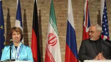 European foreign policy chief Catherine Ashton, left, Iranian Foreign Minister Mohammad Javad Zarif, right, address the media after closed-door nuclear talks in Vienna, Austria, Saturday, July 19, 2014. (Ronald Zak/AP)
