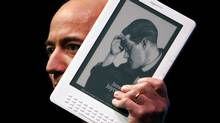 Amazon.com CEO Jeff Bezos holds the Kindle DX. (Spencer Platt/Getty Images)