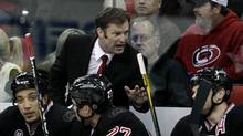 Carolina Hurricanes head coach Kirk Muller, top left, directs the Hurricanes against the Florida Panthers during the first period of an NHL hockey game, Tuesday, Nov. 29, 2011, in Raleigh, N.C. (Gerry Broome/AP)