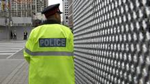 A police officer stands near security fence for the June 26-27 G20 Summit in Toronto June 14, 2010. (MIKE CASSESE/Mike Cassese/Reuters)