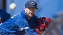 Toronto Blue Jays pitcher Drew Storen pitches spring training in Dunedin, Fla., on Thursday February 25, 2016. (Frank Gunn/THE CANADIAN PRESS)