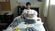 Felix Li, 19, of Tianjin (near Beijing) is getting adjusted at his new home in Kingston, ON, Sunday, Aug. 3, 2014. Felix moved to Kingston to complete grade 12 as a foreign student and then to continue his university education in Canada (Darko Zeljkovic)