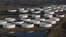 Oil storage tanks stand in Cushing, Okla., in March, 2015. Senior oil traders and executives expect crude to remain between $40 (U.S.) and $60 a barrel over the next 12 months. (Daniel Acker/Bloomberg News)