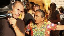 Deepa Mehta works with photography director Giles Nuttgens on the set of Midnight's Children, Mehta's adaptation of the Salman Rushdie novel. (Stephanie Nolen / The Globe and Mail)