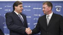 Vancouver Canucks owner Francesco Aquilini, left, introduces Mike Gillis as the new general manager in 2008. (ANDY CLARK/Reuters)