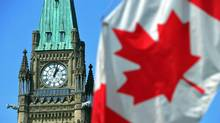 A Canadian flag flies near the Peace Tower in Ottawa on April 27, 2011. (Sean Kilpatrick/THE CANADIAN PRESS)