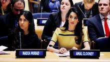 Nadia Murad, a Yazidi woman enslaved by the Islamic State in 2014, and Amal Clooney, a human-rights lawyer, both gave speeches at the United Nations headquarters in New York on Thursday. (LUCAS JACKSON/REUTERS)