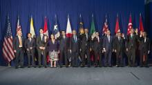 Trans-Pacific Partnership (TPP) leaders wave as they pose for a family photo prior to a meeting on the sidelines of the Asia-Pacific Economic Cooperation (APEC) Summit in Manila on November 18, 2015. (SAUL LOEB/AFP/Getty Images)
