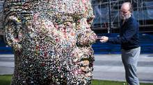 Vancouver based artist Douglas Coupland, near his Gumhead installation, at the Vancouver Art Gallery in Vancouver, B.C., on August 26, 2014. The installation is a large cast of his head and the public were invited to stick their chewed gum on it. (Jimmy Jeong/Jimmy Jeong/www.jimmyshoots.com)