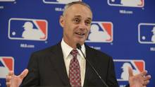 Major League Baseball Commissioner Rob Manfred expects to have a decision within a few days on two of the first three cases covered by the sport's new domestic violence policy. (Paul Beaty/AP)