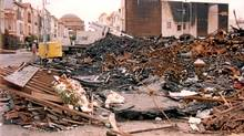 worker surveys the damage caused by the fire in San Francisco's Marina District after the Loma Prieta earthquake struck. (FEMA News Photo)