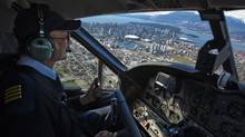 The pilot of a Harbour Air seaplane flies over Vancouver International Airport April 14, 2009. John Lehmann/Globe and Mail (John Lehmann/ The Globe and Mail/John Lehmann/ The Globe and Mail)