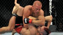 UFC fighter Georges St-Pierre (top) battles Dan Hardy during their Welterweight title bout. (Jon Kopaloff/Getty Images)