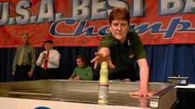 Kim Weaver competes at the National Grocers Association Best Bagger competition.