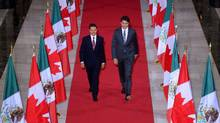 Prime Minister Justin Trudeau and Mexican President Enrique Pena Nieto walk down the Hall of Honour on their way to a signing ceremony on Parliament Hill in Ottawa on Tuesday, June 28, 2016. (Sean Kilpatrick/THE CANADIAN PRESS)