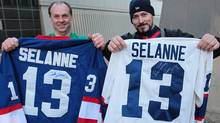Teemu Selanne fans Lee Horton (L) and Scott Gauthier show their signed jerseys after the hockey player greeted fans outside the Fairmont Hotel in downtown Winnipeg on December 17, 2011 in Winnipeg, Manitoba, Canada. Selanne and the Anaheim Ducks are set to play against the Winnipeg Jets tonight at the MTS Centre. This is the first time Selanne has returned to play hockey in Winnipeg, where he began his NHL hockey career with the original Winnipeg Jets in 1992. He was traded in 1996. (Photo by Marianne Helm/Getty Images) (Marianne Helm/Getty Images)