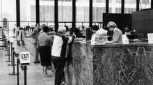 Bank tellers are caught in the broad, structural decline of clerical workers. (James Lewcun/The Globe and Mail)