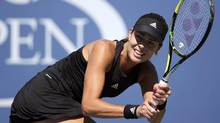 Ana Ivanovich of Serbia hits a return to Karolina Pliskova of the Czech Republic during their match at the 2014 U.S. Open tennis tournament in New York, August 28, 2014. (ADAM HUNGER/REUTERS)