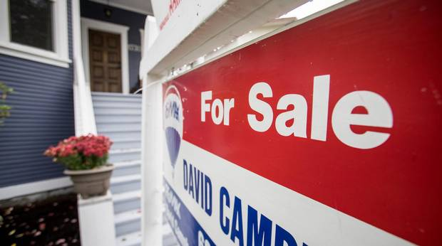 A real estate for sale sign is pictured in front of a home in Vancouver, British Columbia on October 4, 2016 (Ben Nelms/The Globe and Mail)