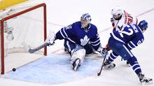 Washington Capitals centre Marcus Johansson scores against Toronto Maple Leafs goalie Frederik Andersen as defenceman Martin Marincin defends during the first overtime period of game six in Toronto on Sunday, April 23, 2017. (Frank Gunn/THE CANADIAN PRESS)