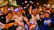 Chicago Cubs fans celebrate outside of Wrigley Field after Game 5 of the Major League Baseball World Series against the Cleveland Indians, Sunday, Oct. 30, 2016, in Chicago. The Cubs won 3-2 as the Indians lead the series 3-2. (Matt Marton/AP)
