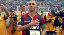 Bologna's Marco Di Vaio receives an award as he salutes fans prior to the Serie A soccer match between Bologna and Napoli at Bologna's Renato Dall' Ara stadium, Italy, Sunday, May 6, 2012. (Studio FN/The Canadian Press)