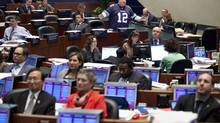 As a symbolic gesture councillors turn their backs as Mayor Rob Ford speaks during a debate for a motion on bike sharing on Nov. 14, 2013. (MOE DOIRON/THE GLOBE AND MAIL)