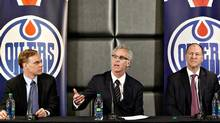 Edmonton Oilers new senior vice-president Scott Howson, left, new general manager Craig MacTavish and team president Kevin Lowe attend a press conference in Edmonton, Alta., on Monday April 15, 2013. (The Canadian Press)