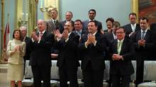 Members of Prime Minister Stephen Harper's cabinet applause as he walk in to the room during a group photo July 15, 2013 at Rideau Hall in Ottawa. (Dave Chan For The Globe and Mail)