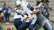Argonauts quarterback Drew Willy is sacked by the Alouettes' John Bowman during play in Montreal on Sunday, Oct. 2, 2016. (Graham Hughes/THE CANADIAN PRESS)