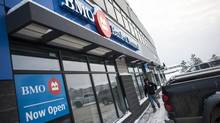 A man leaves a new Bank of Montreal (BMO) branch, located in Fort McMurray, Alta., Tuesday, February 05, 2013. (Brett Gundlock For The Globe and Mail)
