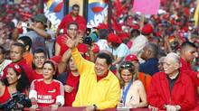 The government of President Hugo Chavez, shown at a campaign rally in Gharenas, Venezuela, on Saturday, confirmed the deaths of two opposition activists and vowed the perpetrators would be brought to justice. (JORGE SILVA/REUTERS)