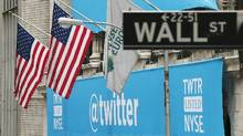 A sign displays the Twitter logo on the front of the New York Stock Exchange in New York on Nov. 7, 2013. (Lucas Jackson/Reuters)