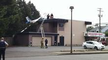 A glider crashed into a building in Langley, B.C., Sept. 8, 2013. (Ben Nelms for The Globe and Mail)