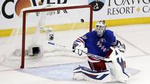 New York Rangers goalie Henrik Lundqvist eyes the puck in the air (JASON SZENES/NYT)