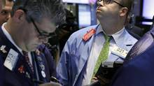 Trader Peter Mancuso, right, works on the floor of the New York Stock Exchange Thursday, Sept. 20, 2012. (Richard Drew/AP)