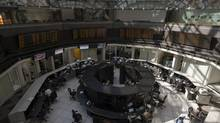 Traders work on the floor of the Bolsa Mexicana de Valores, Mexico's stock exchange, in Mexico City, on Oct. 15, 2012. (Susana Gonzalez/Bloomberg)