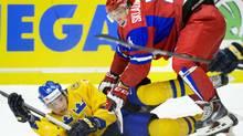 Russia's Nikolas Skladnichenko struggles with Sweden's Oskar Sundqvist (TT NEWS AGENCY/REUTERS)