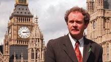 In this May 13, 1997 file photo Sinn Fein's Martin McGuinness walks past the Houses of Parliament in London. The Irish Republican Army commander who led his underground, paramilitary movement toward reconciliation with Britain. (David Thomson/AP)