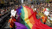 Revellers make their way down Yonge Street during the Gay Pride Parade in Toronto Sunday, June 24, 2007. (AARON HARRIS/CP)