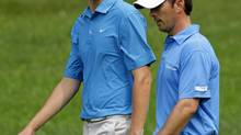 Mike Weir and Matt Hill, back, both from Canada, walk to the ninth green during the practice round of the Memorial Tournament at Muirfield Village Golf Club Wednesday, June 2, 2010, in Dublin, Ohio. (Tony Dejak/The Associated Press)