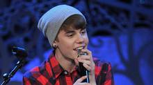 Justin Bieber performs at Massey Hall in Toronto on Wednesday, Dec. 21, 2011. (THE CANADIAN PRESS)
