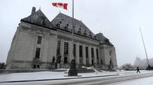 A person walks from the Supreme Court of Canada in Ottawa on Wednesday Feb 27, 2013. (Sean Kilpatrick/THE CANADIAN PRESS)