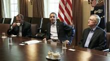 President Barack Obama meets with Senate Majority Leader Harry Reid of Nev., right, and House Speaker John Boehner of Ohio, left. (Carolyn Kaster/AP)