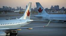 Air Canada jets sit on the runway at Toronto's Pearson airport in 2009. (Fred Lum/Fred Lum/The Globe and Mail)